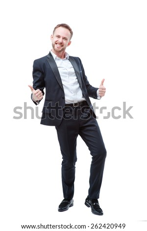 I am winner! Happy young businessman showing thumbs up and gesturing isolated on white - stock photo