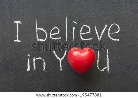 I believe in you phrase handwritten on chalkboard with heart symbol instead of O