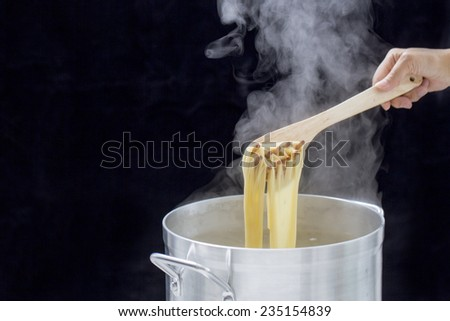 I boil the pasta - stock photo