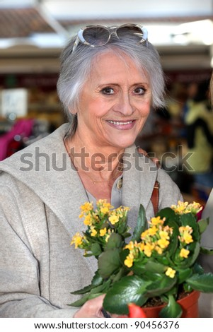 I bought some flowers at the market. - stock photo