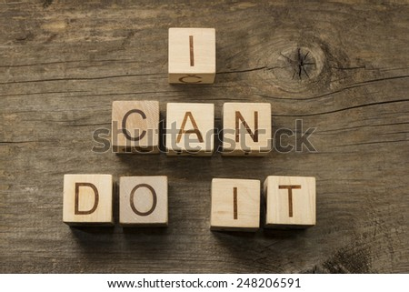 I can do it text on a wooden background - stock photo