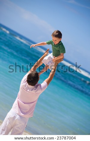 I Can Fly. Happy father and son on the beach. - stock photo