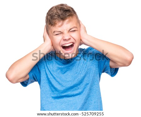 I can not hear anything - portrait of a teen boy 12-14 year old. Half-length emotional portrait of caucasian teenager wearing blue t-shirt. Handsome child, isolated on white background.