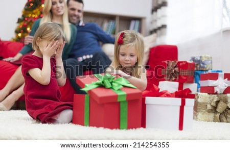 I can't wait to open christmas gift  - stock photo