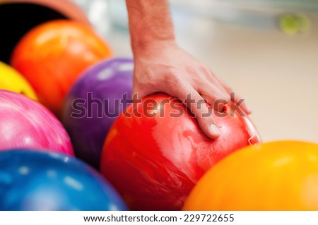 I choose this one. Close-up of a hand holding bowling ball   - stock photo