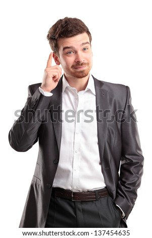 I got an idea - Surprised young businessman isolated on white background - stock photo