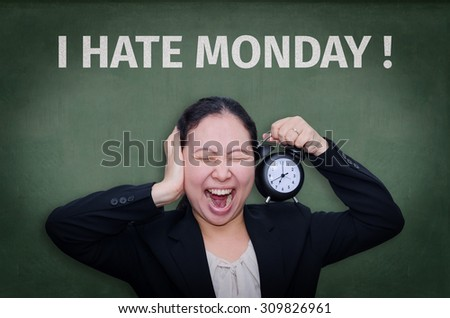 I Hate Monday! written on blackboard with Asian business woman screaming - stock photo