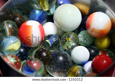 I keep my marbles in a can. - stock photo