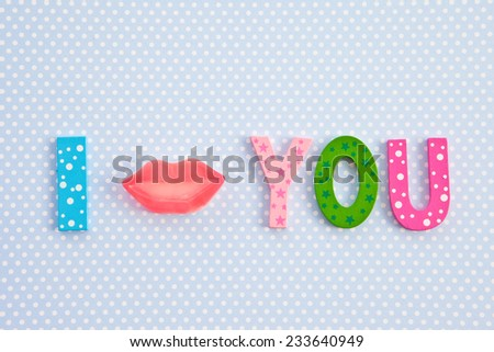 I kiss you written with lip shaped candy - stock photo