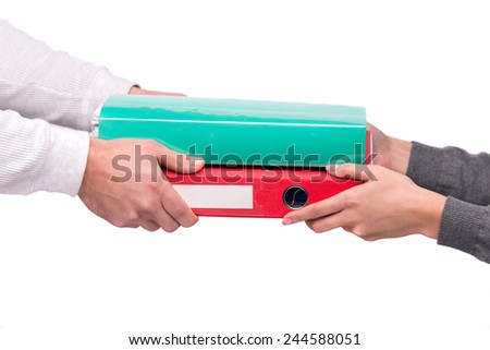 I'll never get through all this. Man passing two folders with heap of paper to his colleague isolated on white background - stock photo