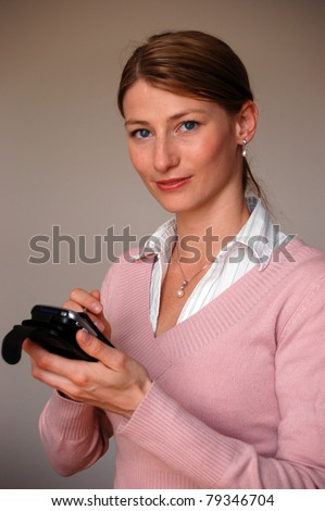 I'll note that - Attractive thoughtful woman holding a pda - stock photo