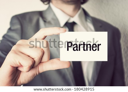 I love business. Businessman in suit with a black tie showing or holding business card in retro vintage style - stock photo