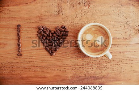 i love coffee, font type Cup of fresh coffee foam cappuccino with heart sign on old retro vintage aged wooden texture board table Good morning background  - stock photo