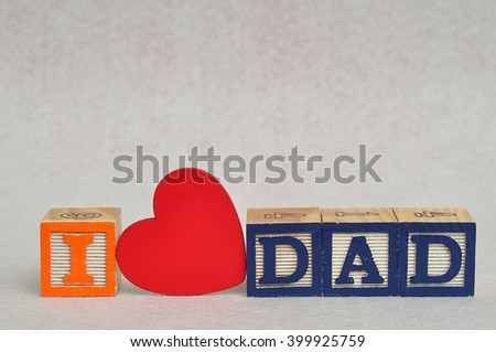 I love dad spelled with colorful alphabet blocks and a red heart isolated on white background - Fathers Day - stock photo