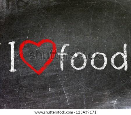 I love food handwritten with white chalk on a blackboard. - stock photo