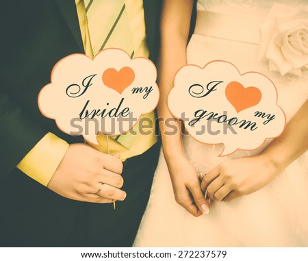 I love my bride. I love my groom. Wedding couple. Toned with retro vintage instagram filter effect. - stock photo