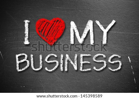 I love My Business handwritten with white chalk on a blackboard