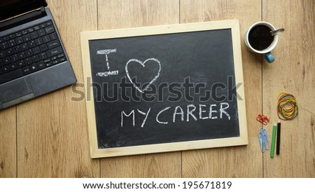 I love my career written on a chalkboard at the office - stock photo