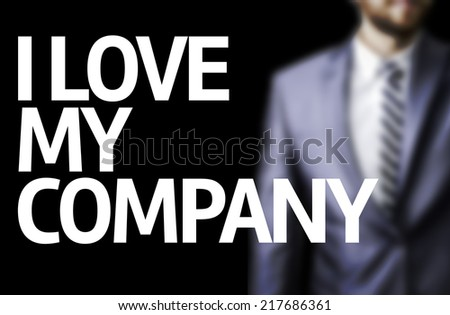 I Love my Company written on a board with a business man on background - stock photo
