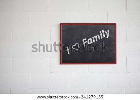 I love my family handwritten with white chalk on a blackboard. - stock photo