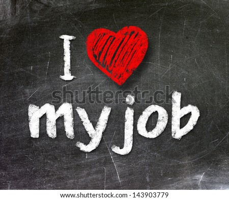 I love my job handwritten with white chalk on a blackboard - stock photo