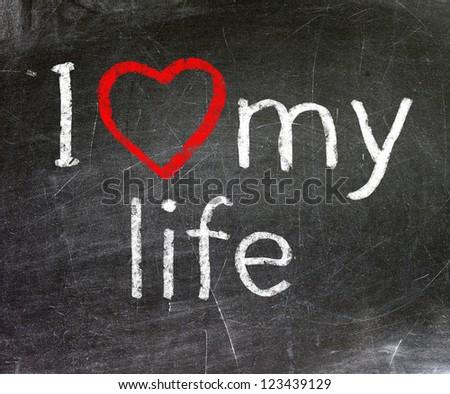 I love my life handwritten with white chalk on a blackboard. - stock photo