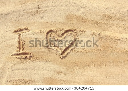 I love - sand writing on sand pattern of a beach in the summer
