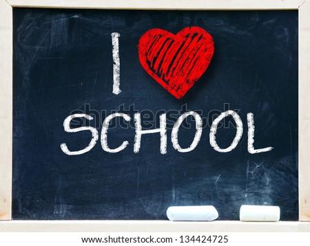 I love school written on a chalkboard. - stock photo