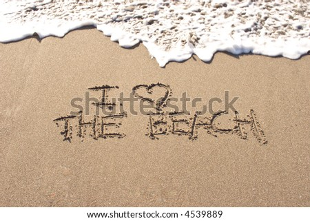 I love the beach written in the sand at Haumoana Beach, Hawke's Bay, New Zealand - stock photo