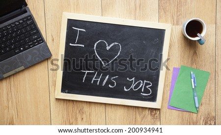 I love this job written on a chalkboard at the office - stock photo