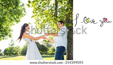 i love you against loving young couple holding hands at park - stock photo
