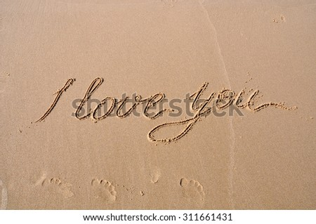 I love you drawing on beach sand - stock photo