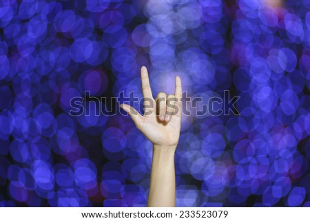 i love you finger gesture on blue bokeh background - stock photo