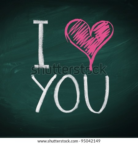 I Love You. Handwritten message on a chalkboard with an illustrated heart used as a symbol of love in this Valentines message. - stock photo