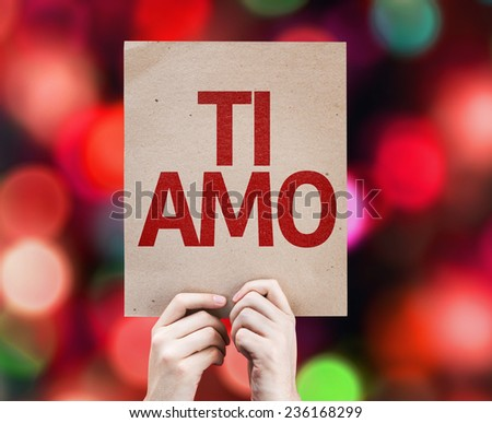 I Love You (In Italian) card with colorful background with defocused lights - stock photo