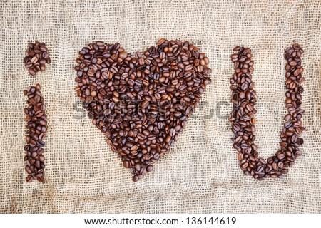 i love you lettering from coffee beans on burlap
