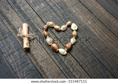 I love you message by shell on wooden background, heart shape, symbol of love with simplicity, idea for valentine day, mother day of father day