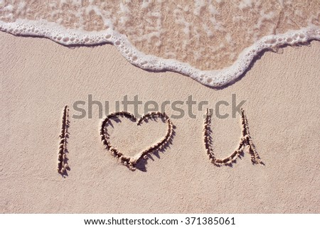 I love you on a sand of beach with wave on background - stock photo