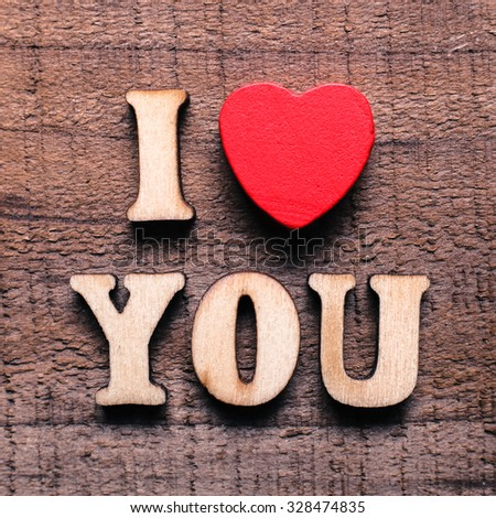 I love you text on the rustic wooden background. - stock photo