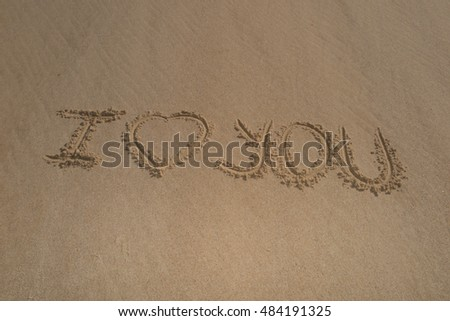 I love you, valentines day written on the sand