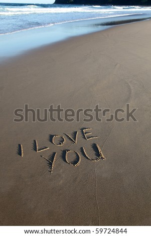 I love you written in the sand at the beach - stock photo