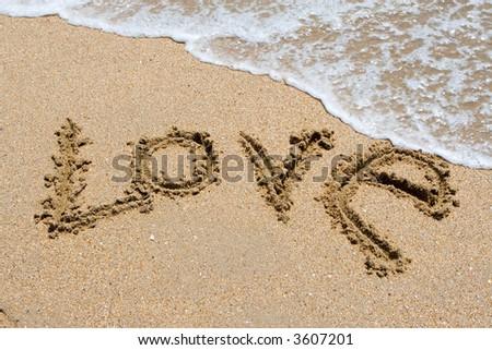 I love you written in the sandy beach - stock photo
