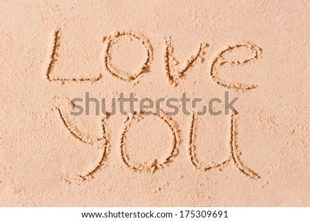 I love you written on wet sand on the beach - stock photo