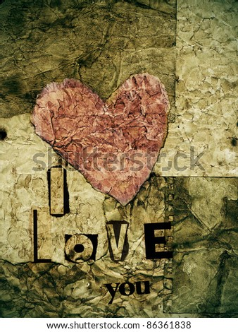 i love you written with with newspaper clippings in a old paper background with a heart - stock photo