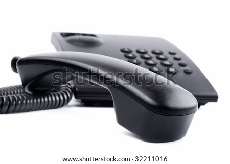I`m a serious business tool: isolated corded phone - stock photo