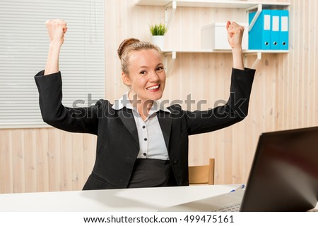 I made a good deal !!! Business woman in office rejoicing his success