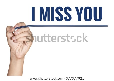 I miss you word write by man hand hold a pen on white background - stock photo