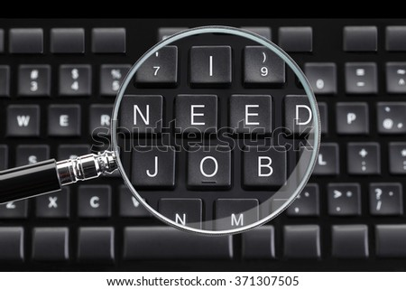 I NEED JOB written on keyboard with magnifying glass