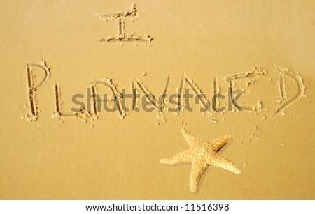 I PLANNED written in beach sand next to starfish - stock photo