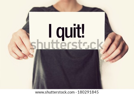 I quit. Female in black shirt showing or holding a card in retro vintage style - stock photo
